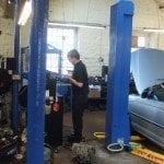 mechanic doing repair work at auto gear box
